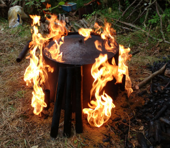 A small kiln flares as the lid is closed