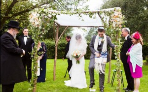 A 'Chuppah' in use at a wedding. A traditional canopy used in Jewish and increasingly, other marriage services