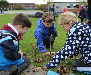 Year 1 pupils at the natural theatre of the school grounds