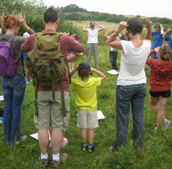 A Wildlife Watch group playing 'sound moose' in Wassledine's meadows