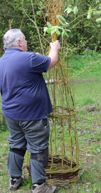 Adding finishing touches to an obelisk made using contorted willow - Wassledine A Day in the Woods