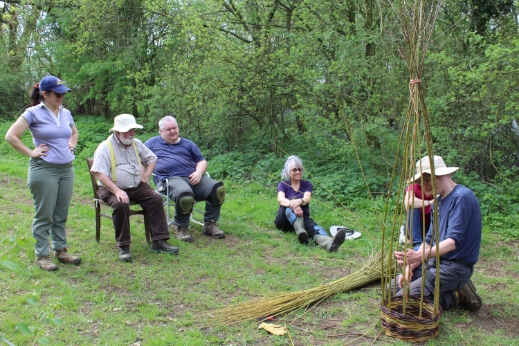 Guy demonstrates a paired weave rising up a willow obelisk - A day in the woods with Wassledine - Saturday 27 April 2019