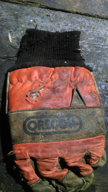 A 4cm gash in the back of a chainsaw glove - the result of a mis-aimed blow with a billhook. Wassledine