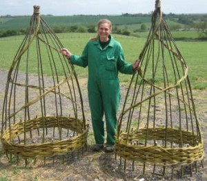 A pair of large willow obelisks