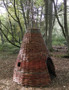 A willow tepee constructed in the grounds of a school